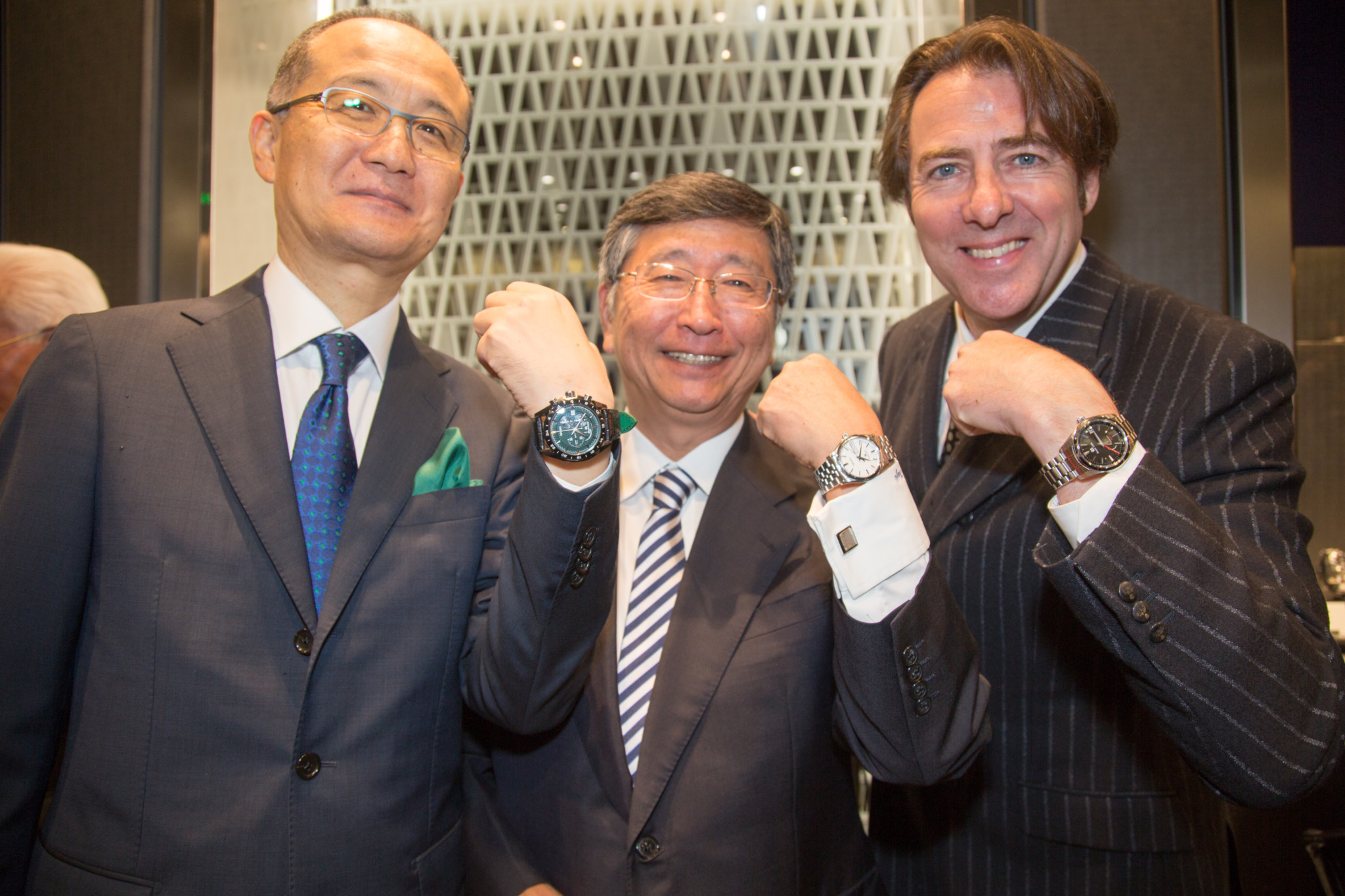 """Seiko's president and chief operating officer was joined by Japan's ambassador to the UK for the official opening of its flagship store in London last month. Shuji Takahashi welcomed ambassador Koji Tsuruoka to the Knightsbridge store, along with invited guests and media. Instead of the usual ribbon-cutting, the store was officially opened when a ceremonial barrel of saki was broken open. TV celebrity Jonathan Ross — who is a passionate student of Japanese culture — helped with the honours. Seiko may be best known for watches priced at under £200, but none of them are on show at the flagship, which has Harrods, Harvey Nichols, Watches of Switzerland and the One Hyde Park Rolex boutique as neighbours in one of London's most affluent shopping streets. Half the store is devoted to Grand Seiko, the top end of the Seiko family, which is a fully integrated manufacture that makes everything from hairsprings to complete movements and cases. The remainder of the boutique displays high end Seiko elite models from Astron, Presage and Prestige collections, the majority of which carry four-figure price tags. The store even displays Credor watches, the highest horological watch brand in the Seiko family. Mr Takahashi said that the store is more than just a point of sale for London, it is a """"global flagship"""" designed to raise the profile of Seiko in the UK and for visitors from around the world. He added that Seiko's retail partners will benefit from the opening of the flagship because it will raise the prestige of the Seiko brand in the country. """"Every city where we we have opened our own boutique has seen retailers benefit from the increased profile it brings,"""" Mr Takahashi added."""
